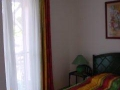 2ème chambre climatisée avec sa porte fenêtre