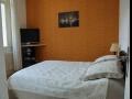 La chambre lit 140x190 literie Pullman