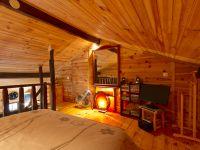 Chambre en mezzanine, écran plat, lecteur DVD et choix de films