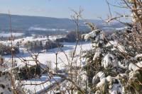 paysage enneigé vue de la terrasse du chalet