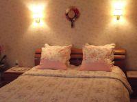 Le chambre rose le lit de 160x200