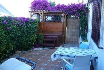 pergola avec jacuzzi sur grande terrasse