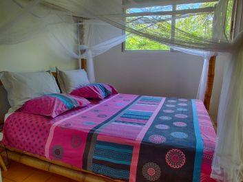 La chambre du bungalow Ylang